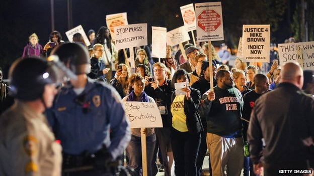 "Police face off with demonstrators as protests continue in the wake of 18-year-old Michael Brown""s death on October 22, 2014 in Ferguson, Missouri."