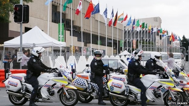 Police officers are seen at the car entrance of the Brisbane Convention and Exhibition Centre on 12 November 2014 in Brisbane, Australia.