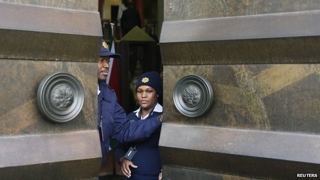 Police officers closing parliament's doors in Cape Town, South Africa in August 2014