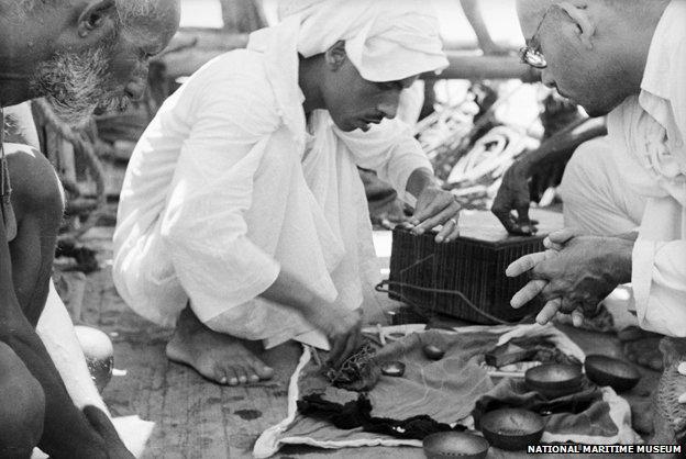 Merchant examines pearls