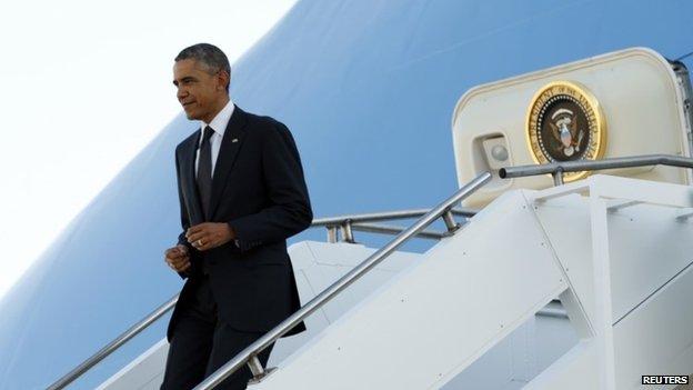 US President Barack Obama steps from Air Force One upon arrival in Brisbane on 15 November 2014.