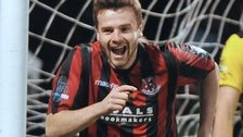 Crusaders substitute Nathan Hanley celebrates after scoring the final goal in the 4-1 win over Cliftonville
