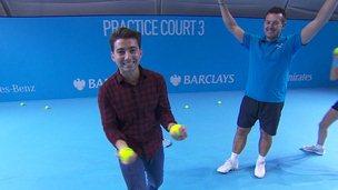 Ricky practising his ball boy skills