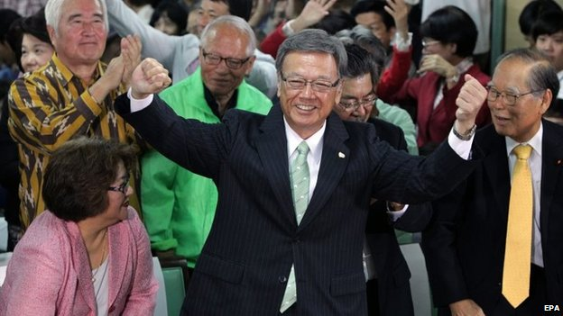 Takeshi Onaga (centre) performs a dance celebrating his victory at the Okinawa gubernatorial election in Naha, southern island of Okinawa, Japan, 16 November 2014