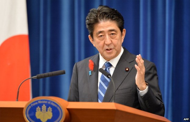 Japanese Prime Minister Shinzo Abe speaks during a press conference at his office in Tokyo on 1 October 2013.