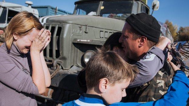 Relatives and friends meet Ukrainian servicemen returning from duty in eastern Ukraine