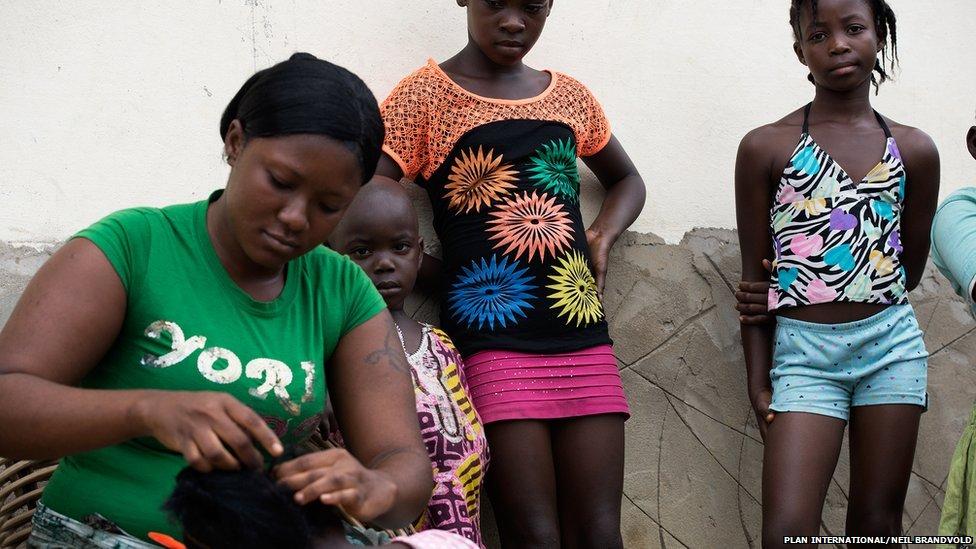 Fatu, 28, braids sister Princess's hair