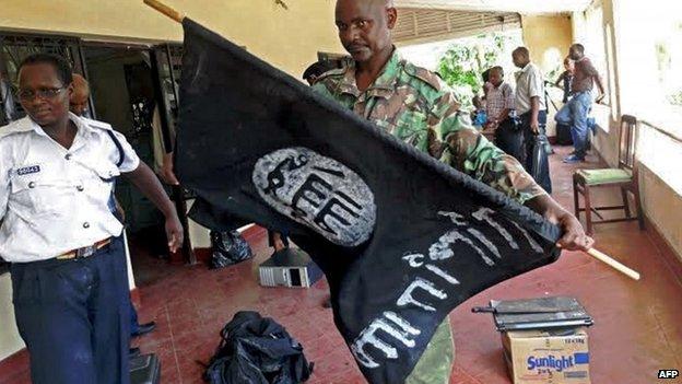 Kenyan policeman with black flag