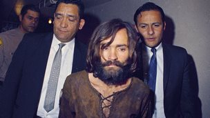Charles Manson escorted to his arraignment on conspiracy-murder charges in connection with the Sharon Tate murder case, 1969, Los Angeles