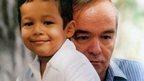 Islam Karimov Sr embracing Islam Karimov Jr