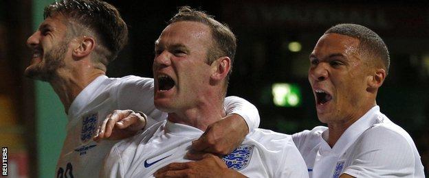 Wayne Rooney celebrates with Adam Lallana and Kieran Gibbs after England's third goal