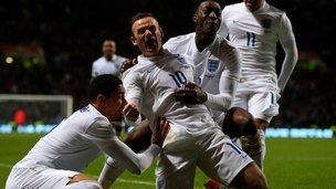 Wayne Rooney celebrates header against Scotland