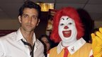 Indian Bollywood actor Hrithik Roshan (L) poses with Ronald McDonald the clown