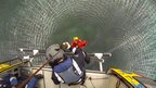 A crewman's view as he operates the helicopter's winch
