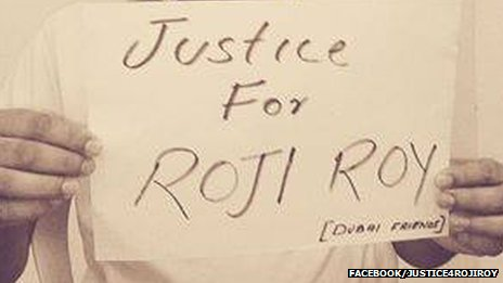 Photo of placard reads 'Justice for Roji Roy'