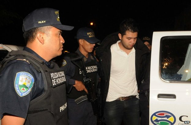 Aris Valentin Maldonado is escorted by police in Santa Barbara, Honduras, 18 November