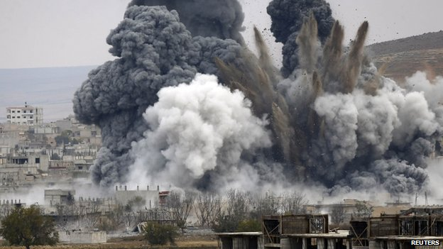 An explosion following an air strike in central Kobane in Syria (17 November 2014)