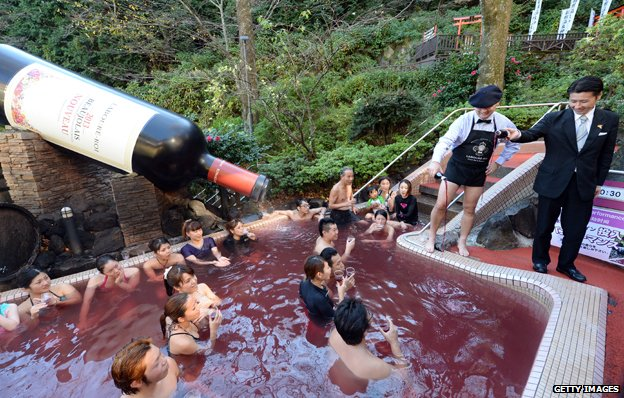 Beaujolais Nouveau wine is poured into the wine spa at the Hakone Yunessun spa in Hakone town, Japan
