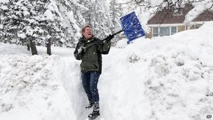 Sue Radka helps shovel out a friends driveway on in Lancaster, N.Y.
