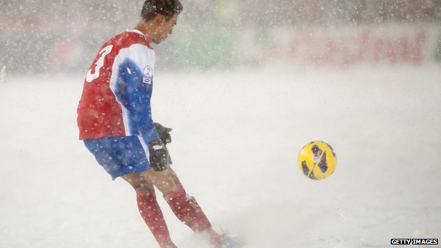 A US football player kicks a ball in the snow against Costa Rica in 2013.