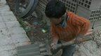 Child moving bricks in Bolivia