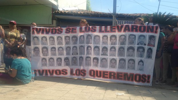 A banner showing the 43 Mexico students, who are missing, presumed dead