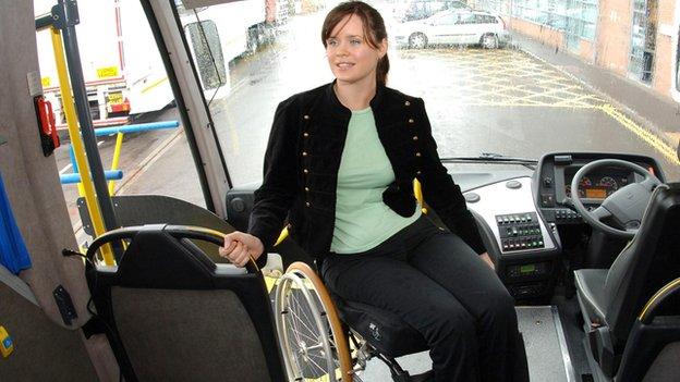 A wheelchair user boards a coach