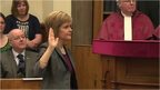 Nicola Sturgeon with hand raised to take oath