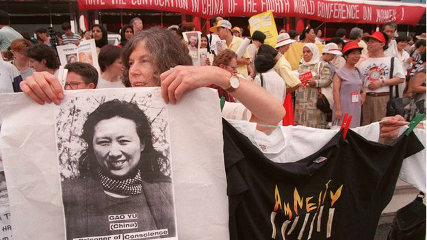 Photo dated 31 August 1995 shows a member of Amnesty International displaying a picture of Chinese prisoner of conscious Gao Yu at a demonstration in Huairou during the Women's NGO Forum.