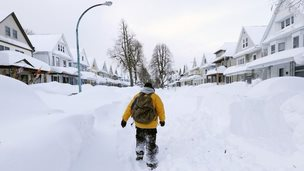 Man walks through snow-covered Buffalo in New York state