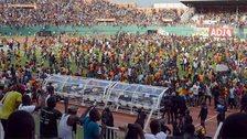 The pitch invasion in Abidjan