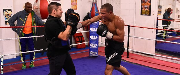 Chris Eubank Jnr in action during a training session at the Brighton and Hove Boxing Club watched by his dad Chris Eubank Snr