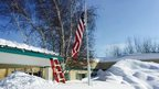 Snow reaches far up a flagpole in the US