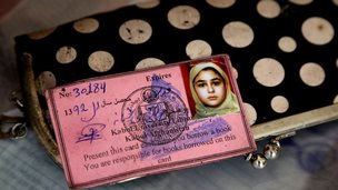 pink library card showing young girl's photograph