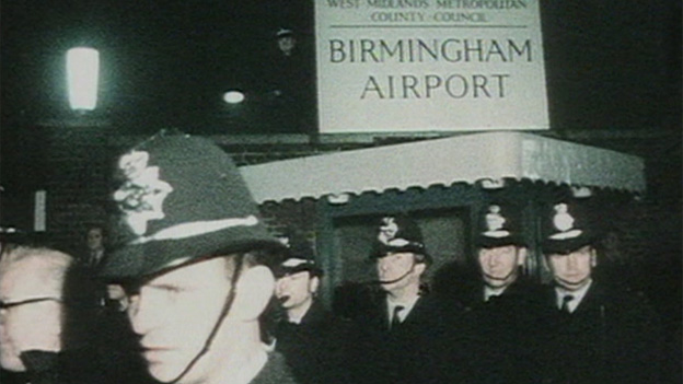 Police at Birmingham Airport waiting for James McDade's body to arrive