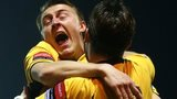 Maidstone players celebrate their FA Cup win over Stevenage