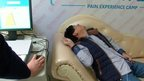 Man on couch receiving electric currents