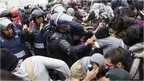 Riot police scuffle with demonstrators during a protest over the 43 missing Ayotzinapa students, near the Benito Juarez International airport in Mexico City November 20, 2014