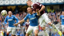 Kevin McHattie wins the ball against Kenny Miller