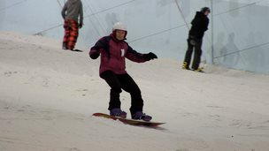 Norma Peace snowboarding on the slopes
