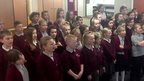 A school in West Yorkshire sings Let Them Know