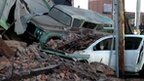 Building collapsed onto cars following a car chase