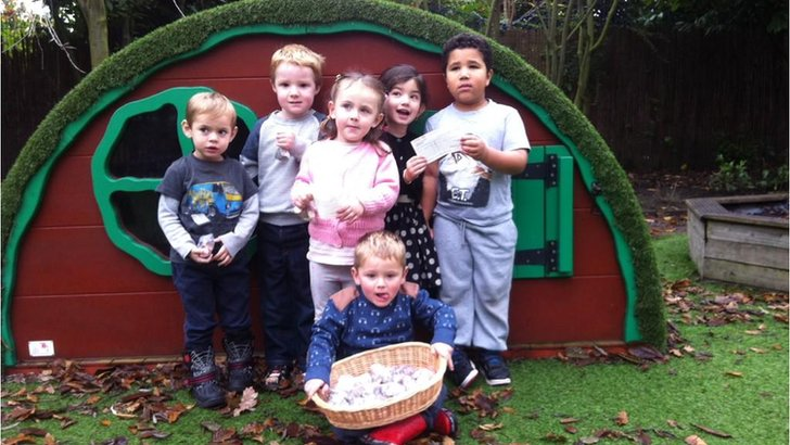Nursery pupils with donations