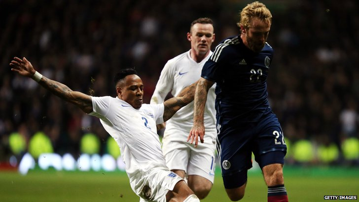 Johnny Russell in action against England