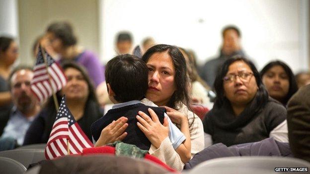 Martha Moran, with her six-year-old son Tonatiuh Moran, watch Obama speech