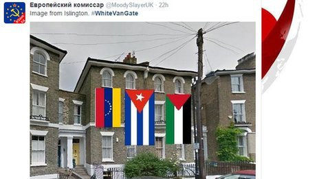 House with images of Palestinian, Cuban and Venezuelan flags