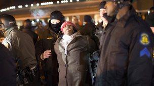 Police arrest a demonstrator in Ferguson, Missouri, on 20 November 2014