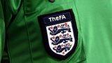FA badge on referee's shirt