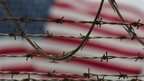 Barbed-wire fence and US flag