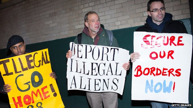 Three men protest President Obama's immigration action in New York City